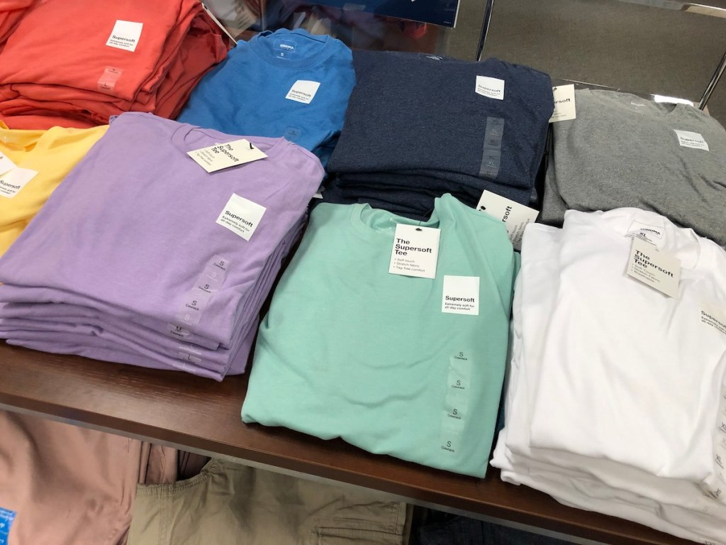 men's t-shirts sitting on table