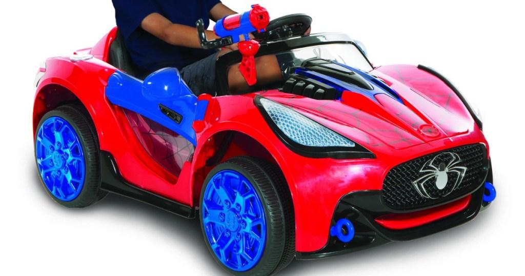 boy riding in spiderman car