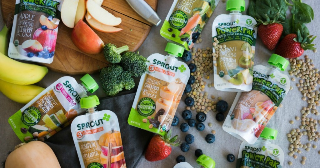 Variety of Sprout Organics Baby Food Pouches surrounded by fruits and vegetables