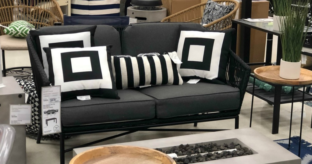 black patio loveseat with white black pillows