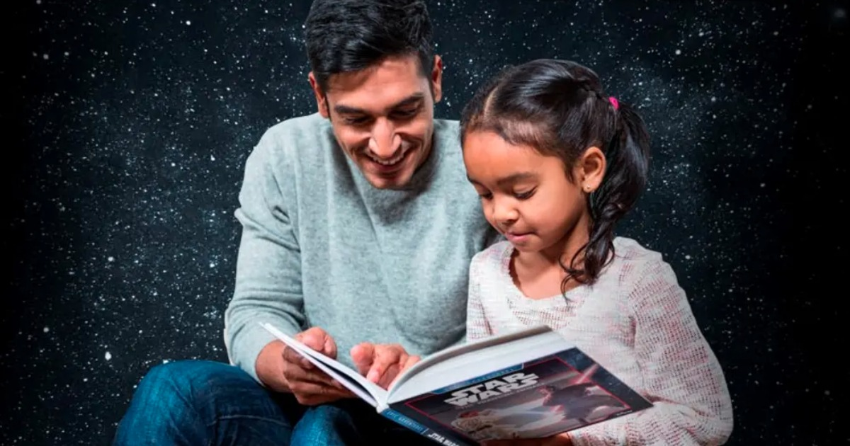 man and girl reading a Star Wars book