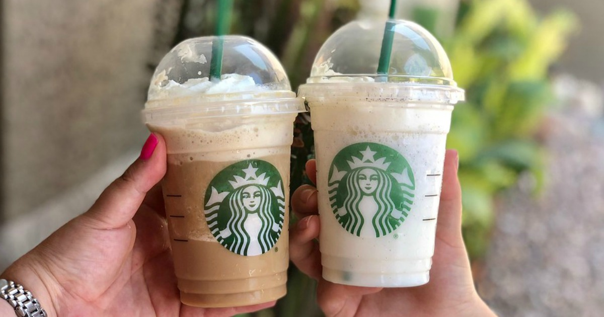 two Starbucks Frappuccinos being held outside