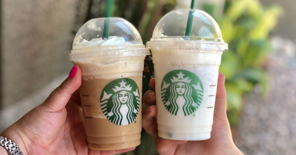 two Starbuks Frappuccinos being held outside