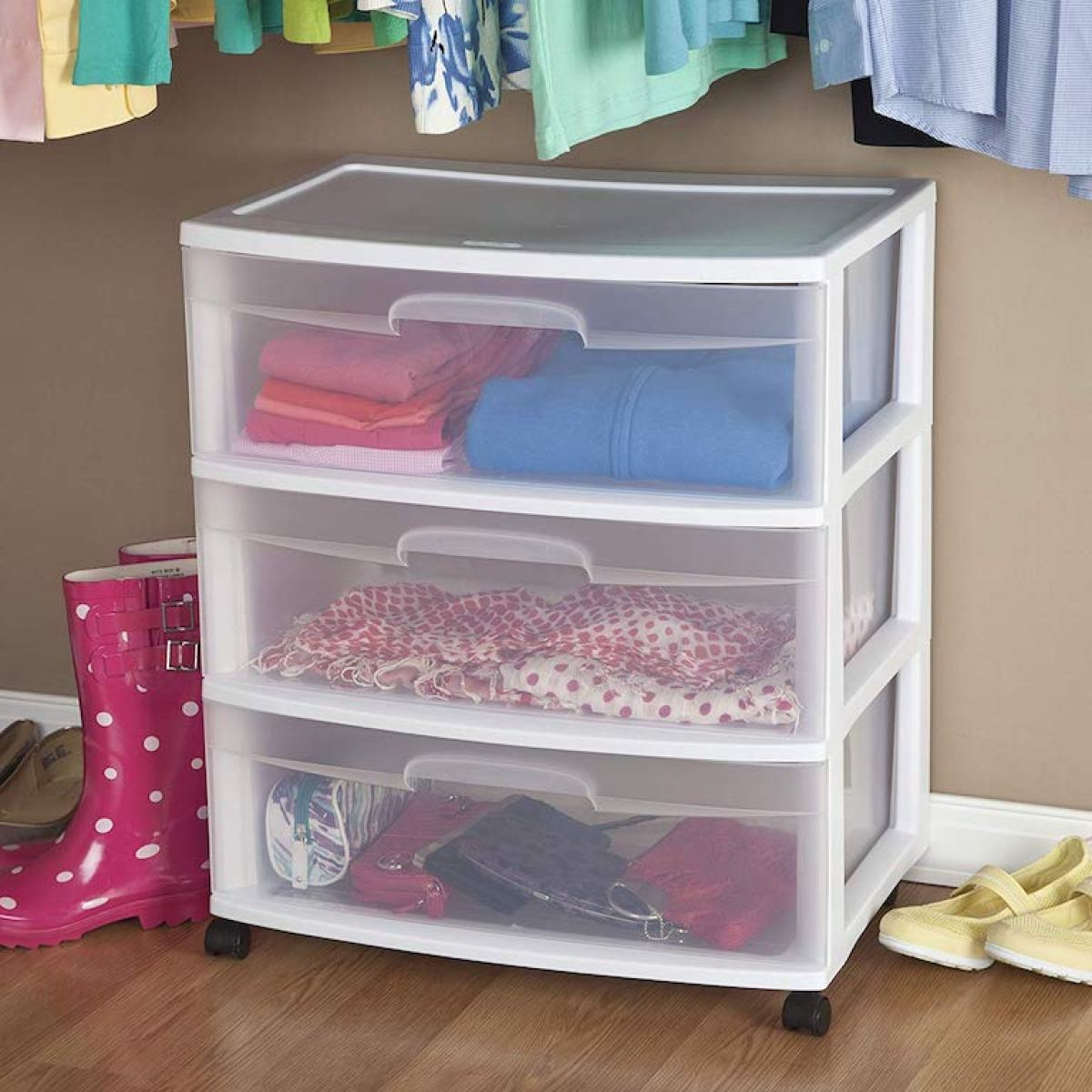 Sterilite Cart with clothing in it in a closet with a hardwood floor