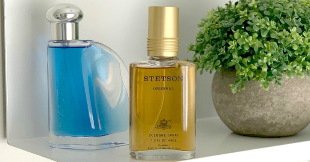 Stetson and Nautica men's cologne on shelf with plant
