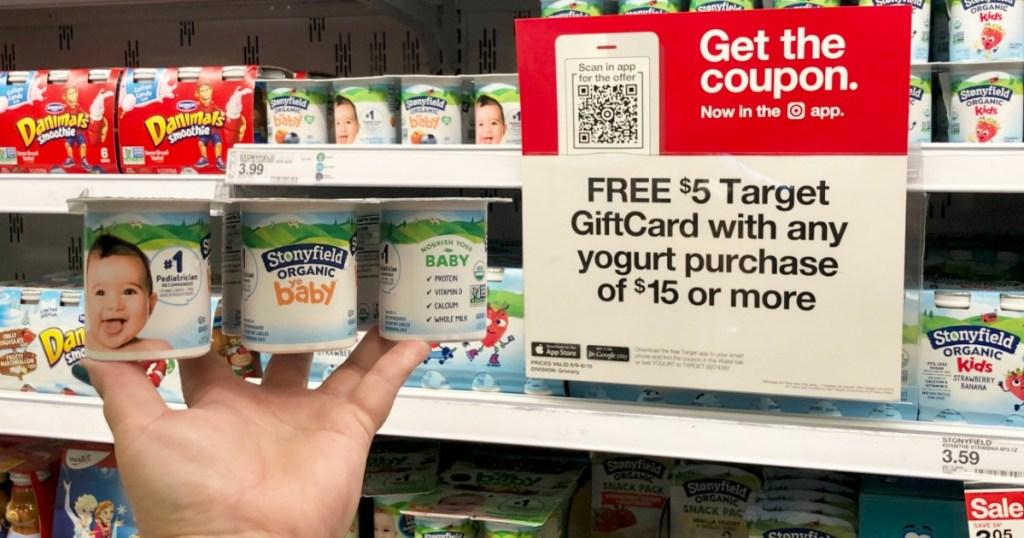 hand holding Stonyfield Organic Baby Yogurt at Target