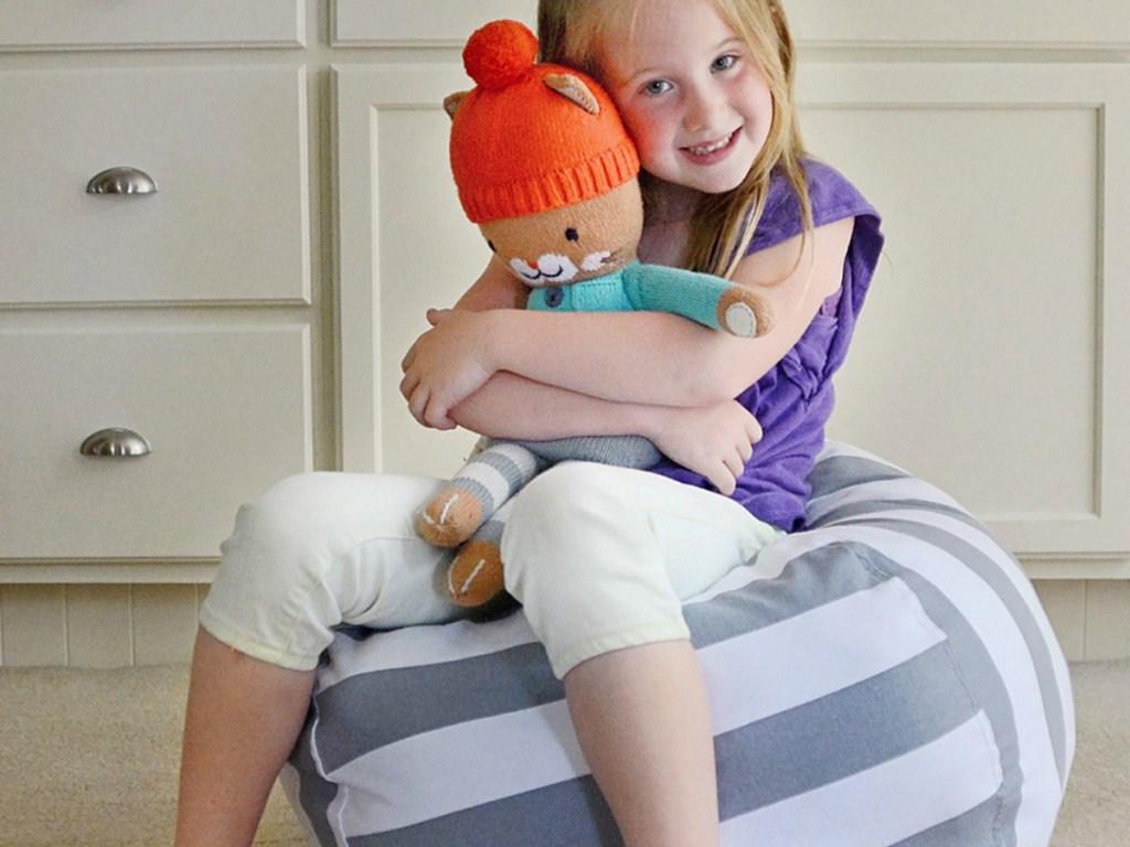 Girl sitting on Striped Creative QT Storage Bean Bag