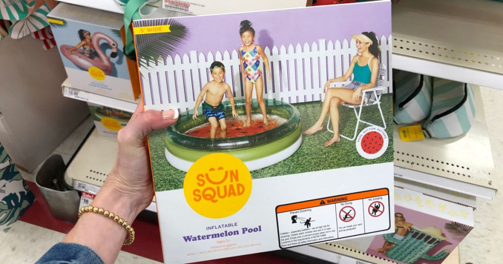 Woman holding sun squad inflatable watermelon pool in target