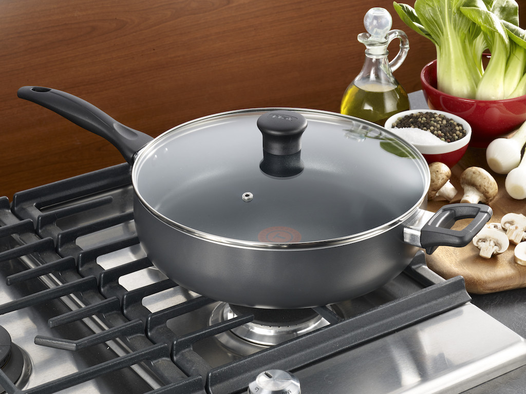 T-fal Easy Care fry pan sitting on a stove with the lid on