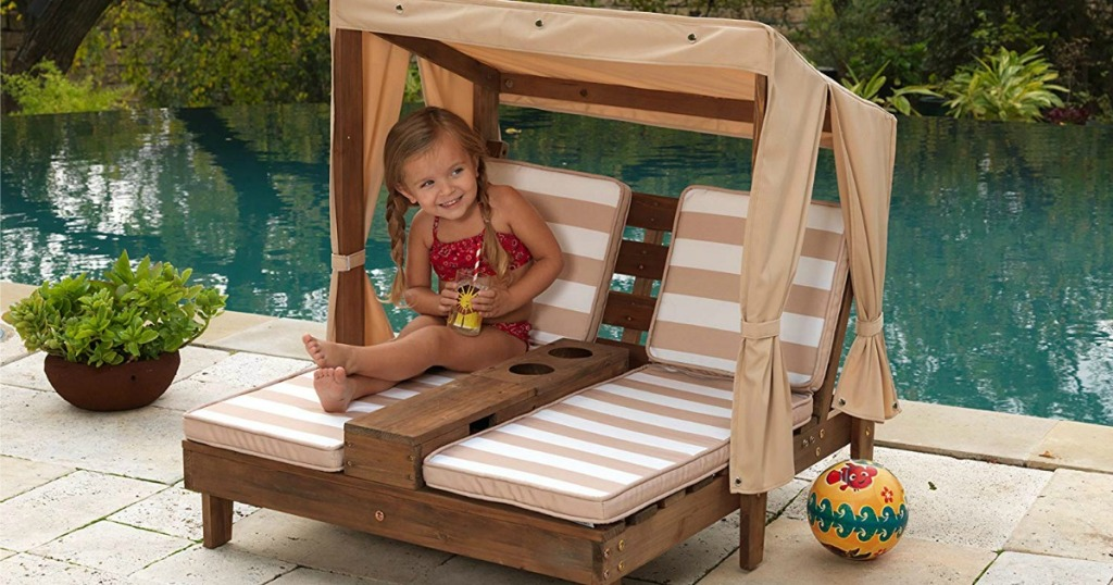 two seat children's lounger with striped cushions and tan canopy