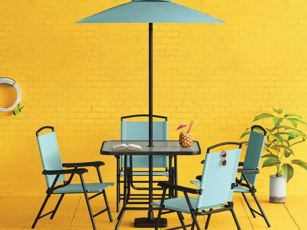 patio table with blue-green chairs