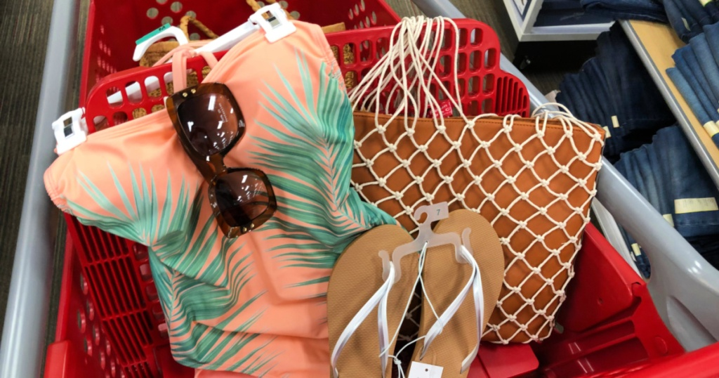 Coral and palm tree one piece with glasses, flip flops, and purse in target cart