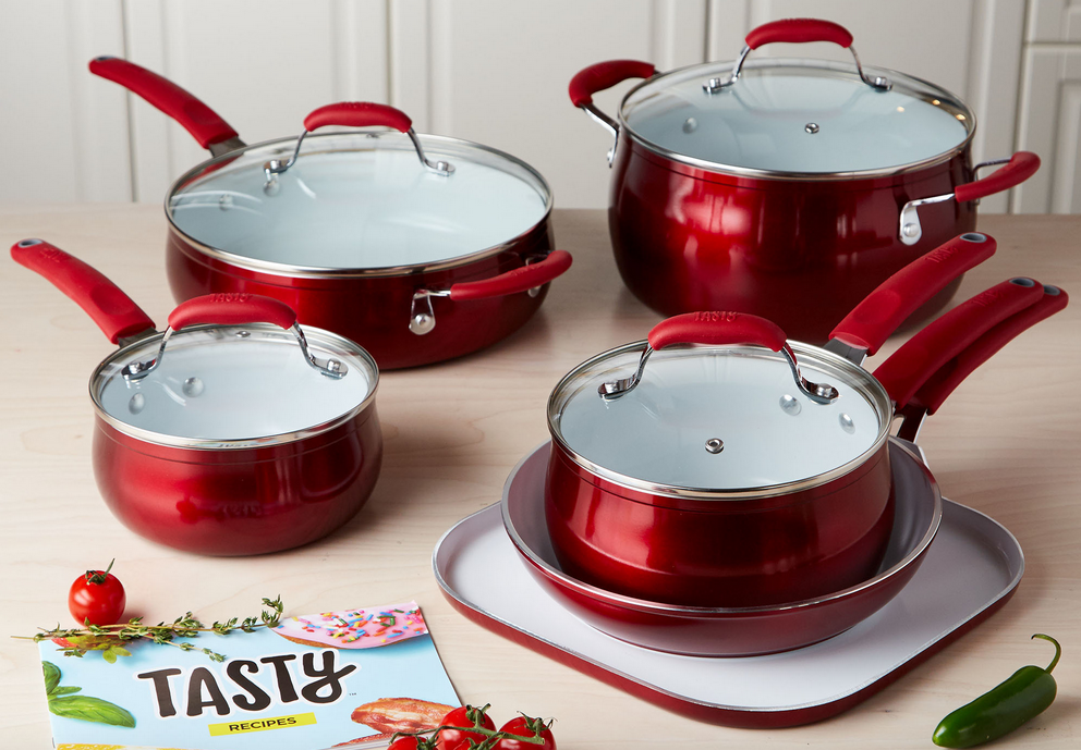 Red set of Tasty Cookware displayed on table