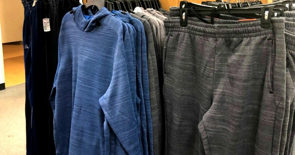 Men's Hoodie hanging next to pants at Kohl's