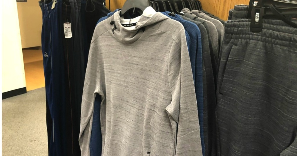 men's hoodie hanging in Kohl's next to a pair of matching pants