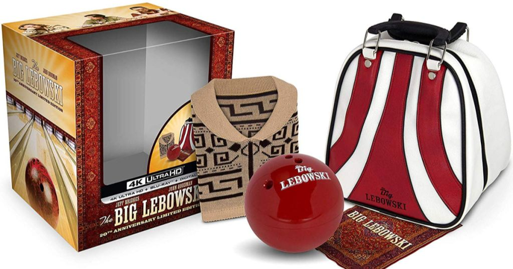 The Big Lebowski 20th Anniversary Limited Edition gift set with collectible bag, ball pencil holder, polishing cloth, and sweater packaging