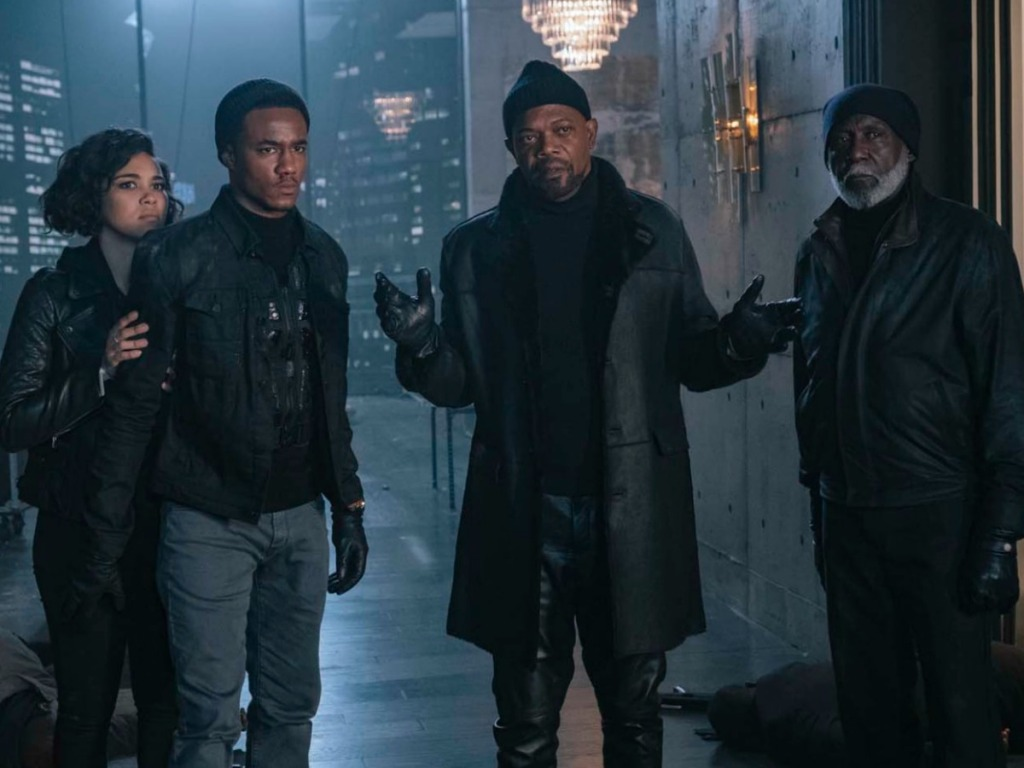 four men dressed in black standing outside for The Shaft movie
