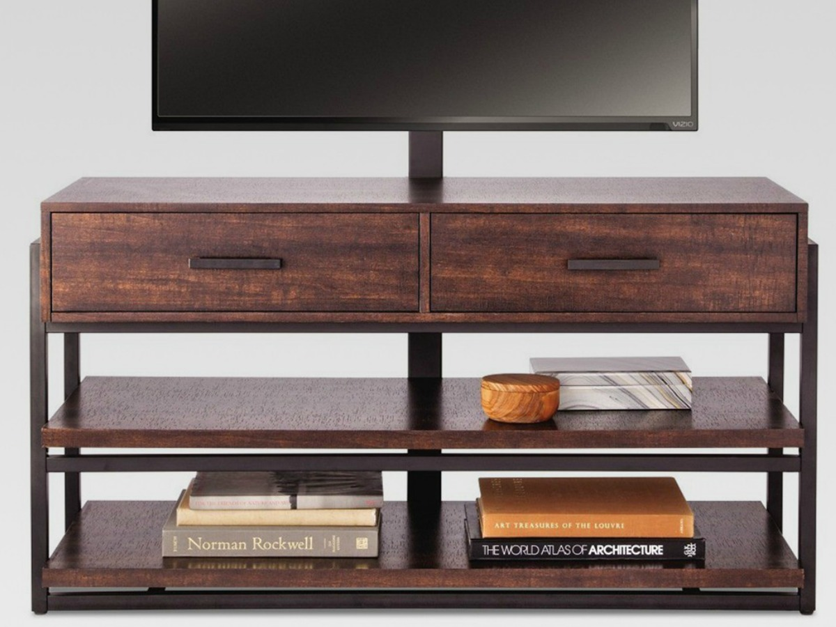 wood tv stand with four open shelves and two drawers holding a tv