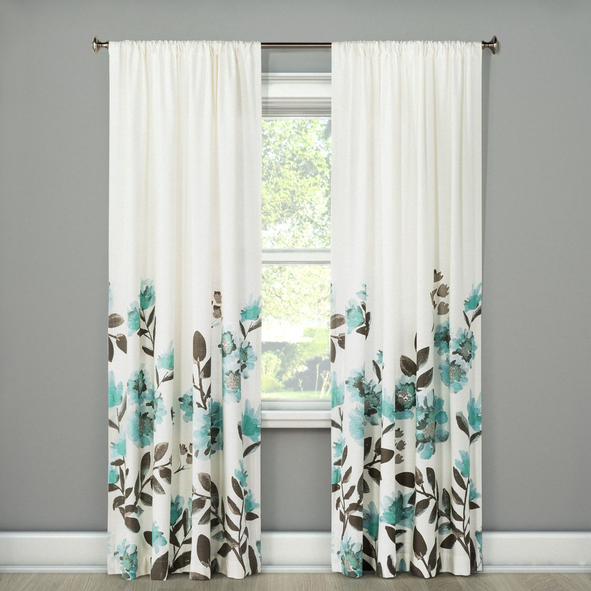 curtain panels with flowers climbing up hanging on window