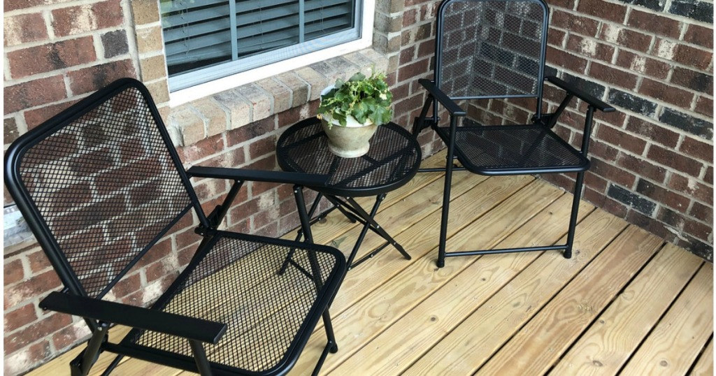 Metal Folding Patio Table And Chairs On A Deck