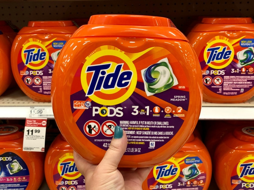 Tide Pods held up in front of Target Shelf