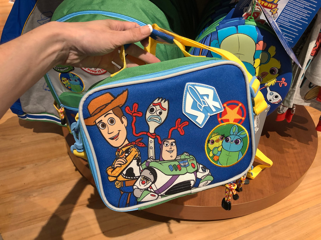 Toy Story 4 Lunch Box being held by a woman's hand at shopDisney
