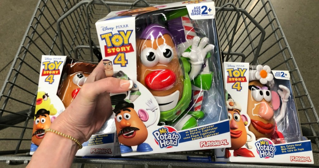 Woman holding Hasbro Toy Story 4 Mr. Potato Head above shopping cart