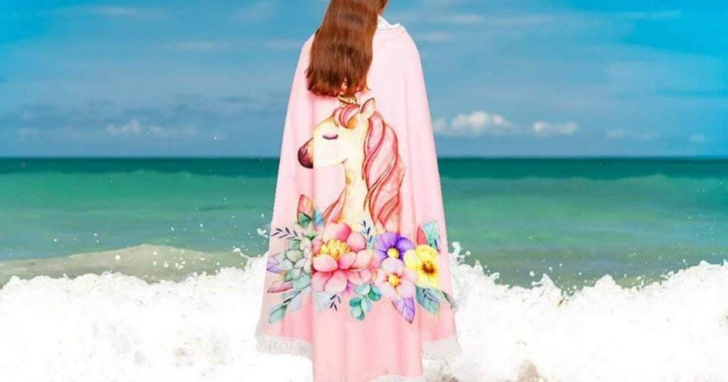woman wearing Unicorn round beach towel at the beach