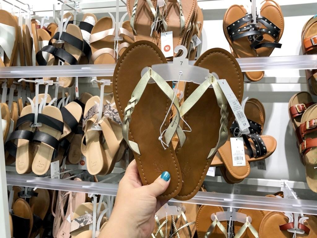 hand holding Universal Thread women's sandals