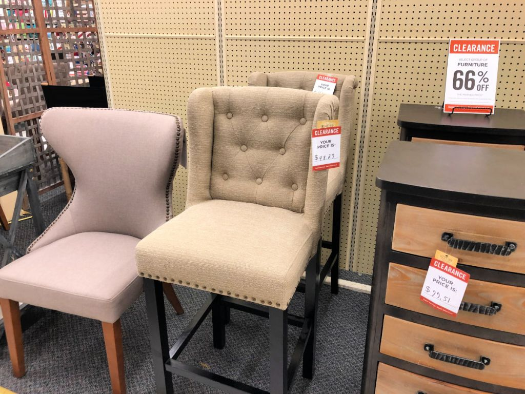 beige upholster high back chair in hobby lobby with tall storage drawers and mauve dining chair