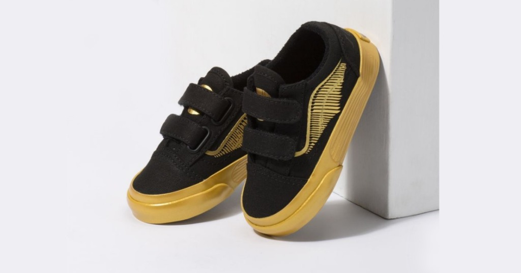 harry potter vans gold snitch shoes against a gray background