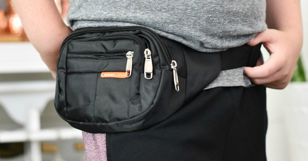 black fanny pack with multiple zippers and pockets