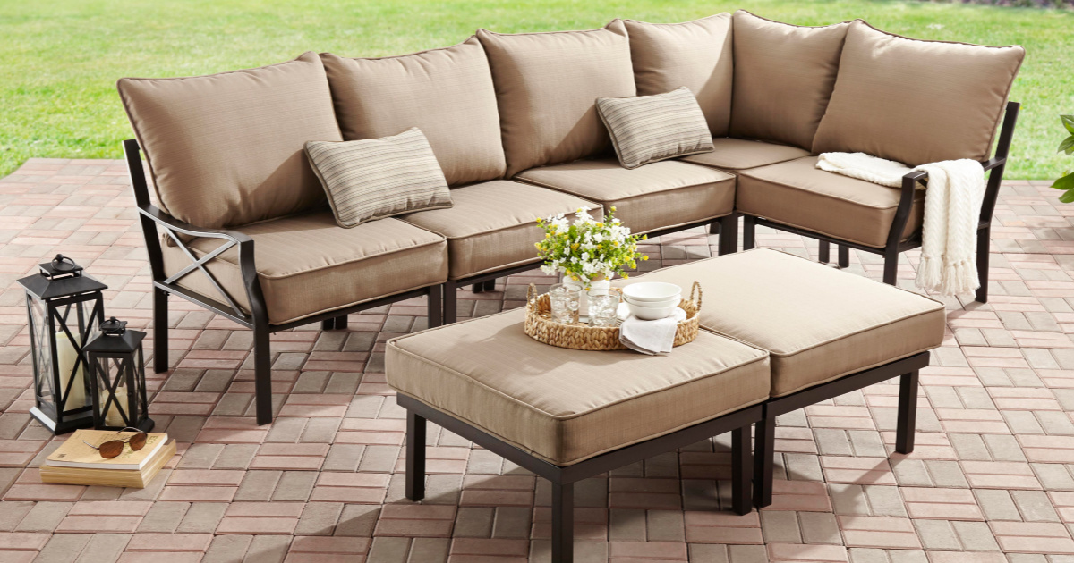 Tan Outdoor Sectional Sofa With Matching Table Sitting On A Brick Patio