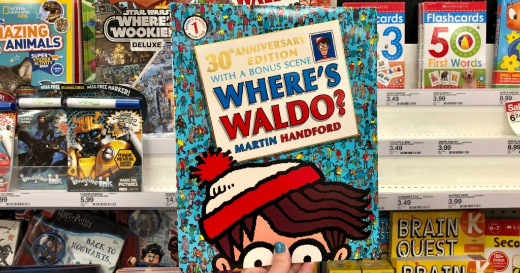 hand holding Where's Waldo book