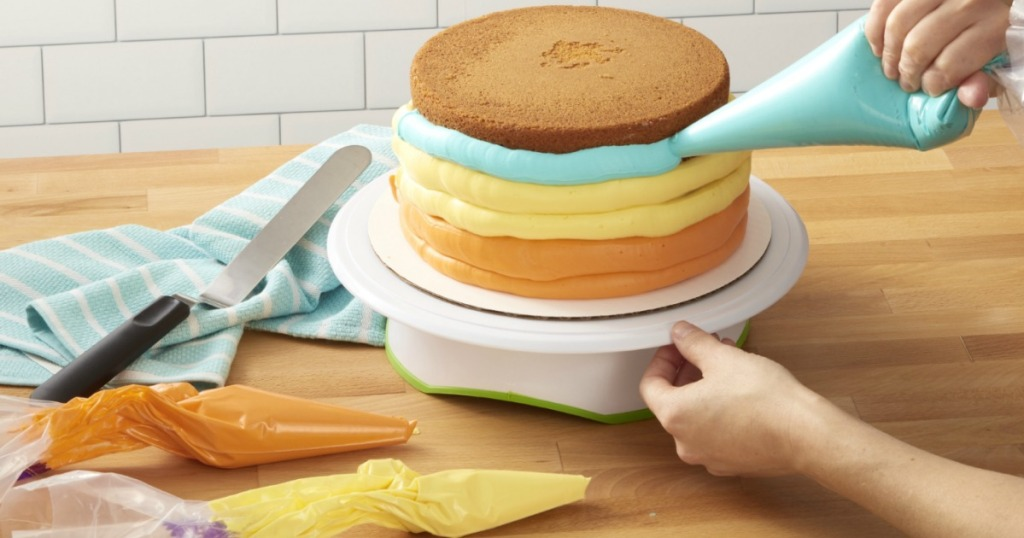 lady decorating a cake with Wilton cake decorating disposable bags