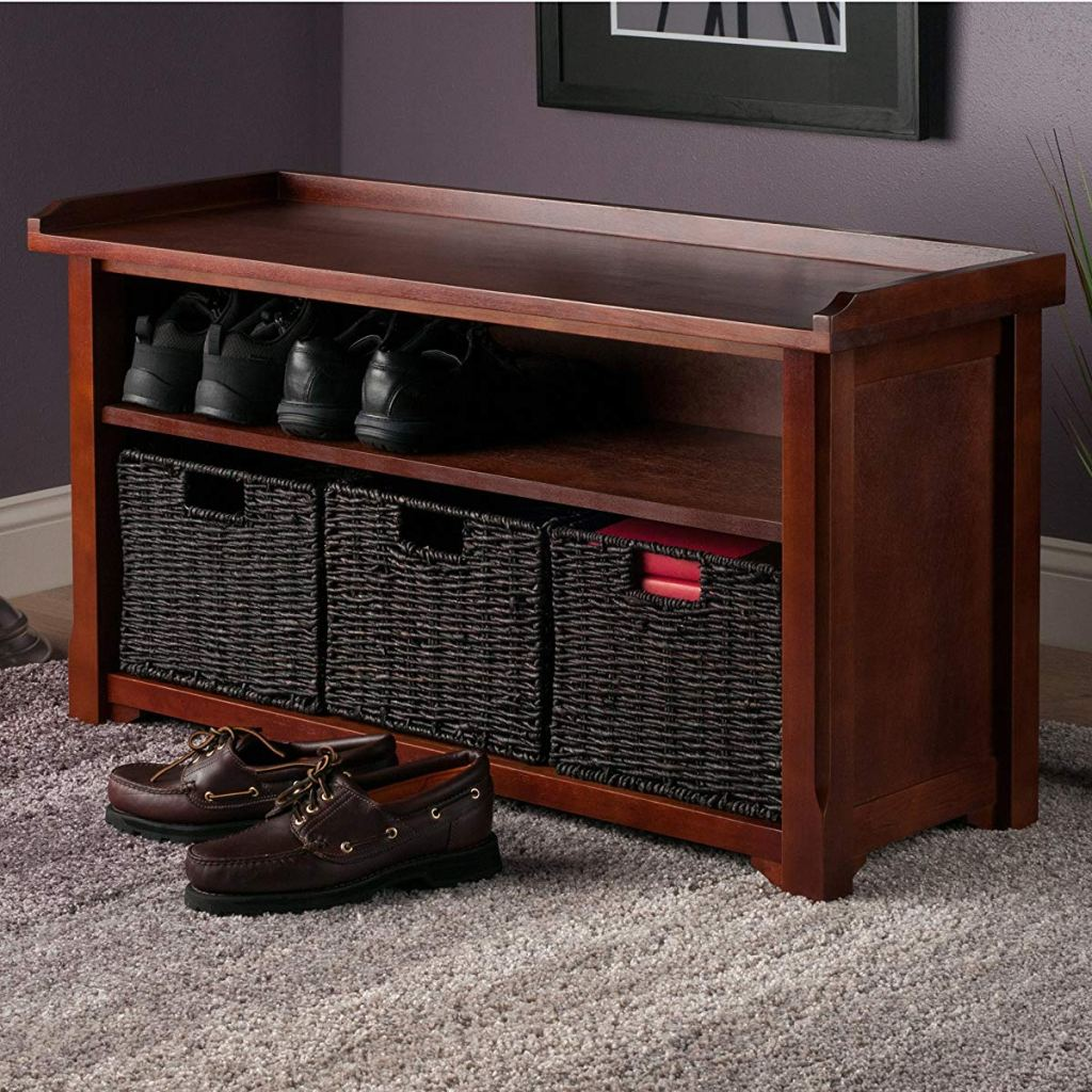 storage bench with shoes and baskets on it