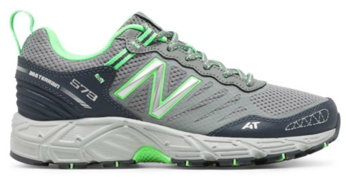 grey, green and white new balance running shoe
