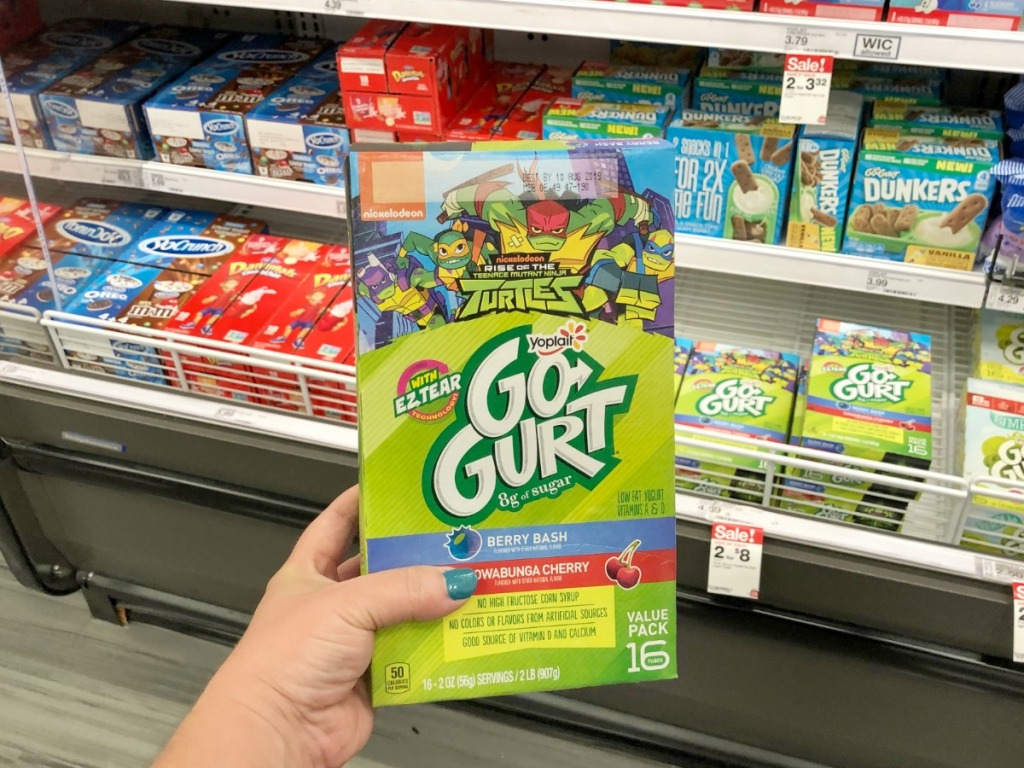 Hand holding big gogurt yogurts featuring Teenage Mutant Ninja Turtles