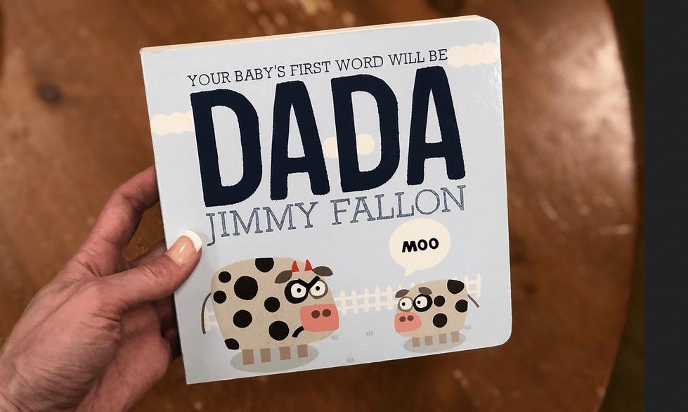 Woman holding DADA Board book by Jimmy Fallon
