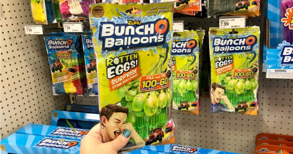 bunch o balloons rotten eggs package held by hand