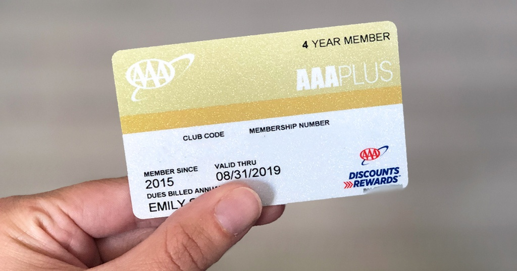 holding up triple a (aaa) membership card