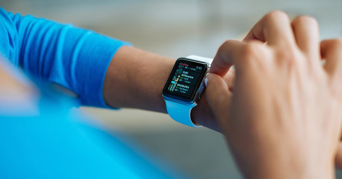 woman wearing a smart watch using achievement app