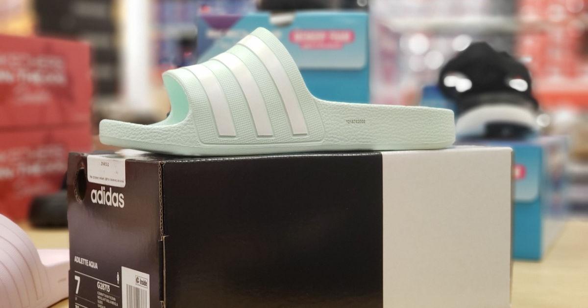 adidas aqua womens slides on shoe box on store shelf