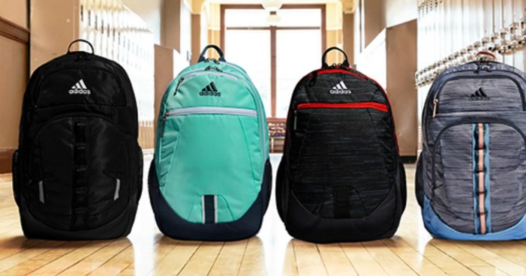 adidas backpacks displayed on school floor