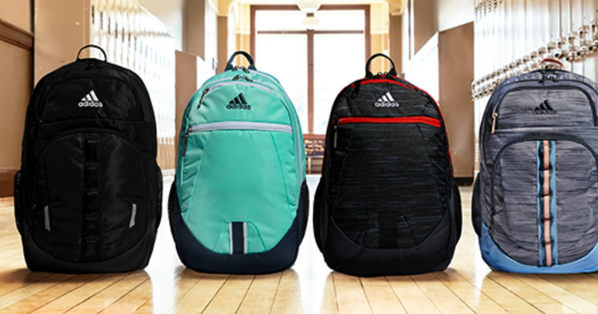 adidas backpacks lined up in a school hallway