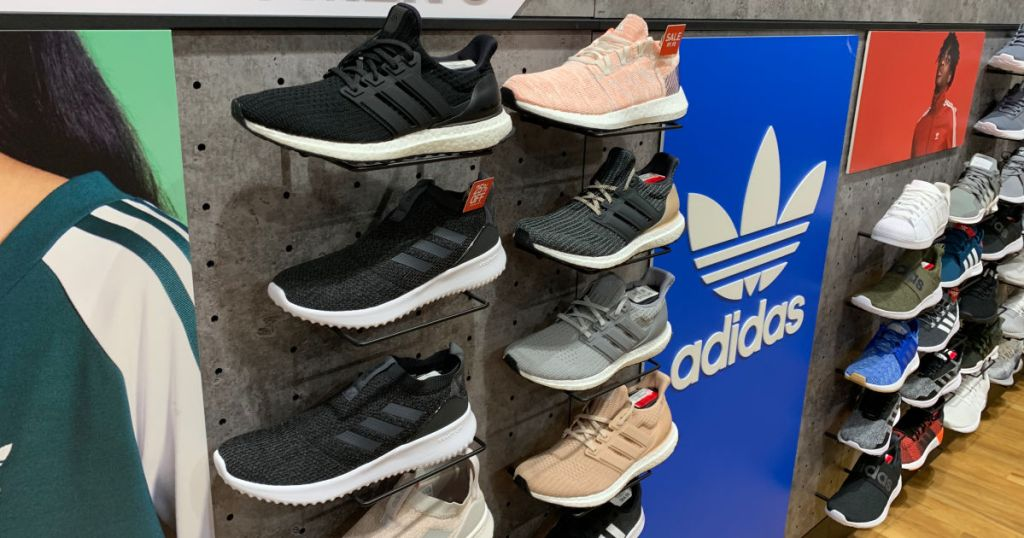 wall of adidas sneakers with adidas logo