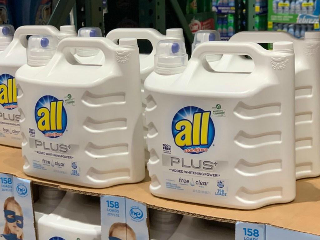 bottles of laundry detergent on store display shelves