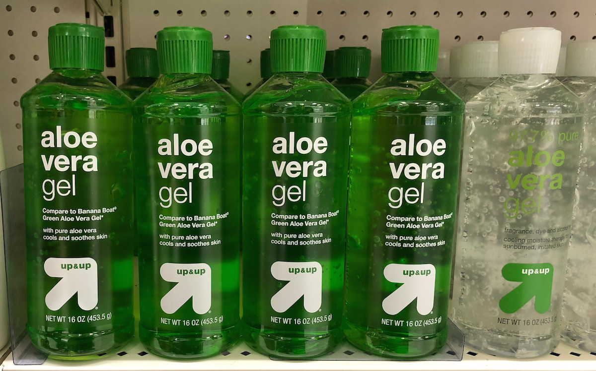 bottles of green and clear aloe vera on store shelf