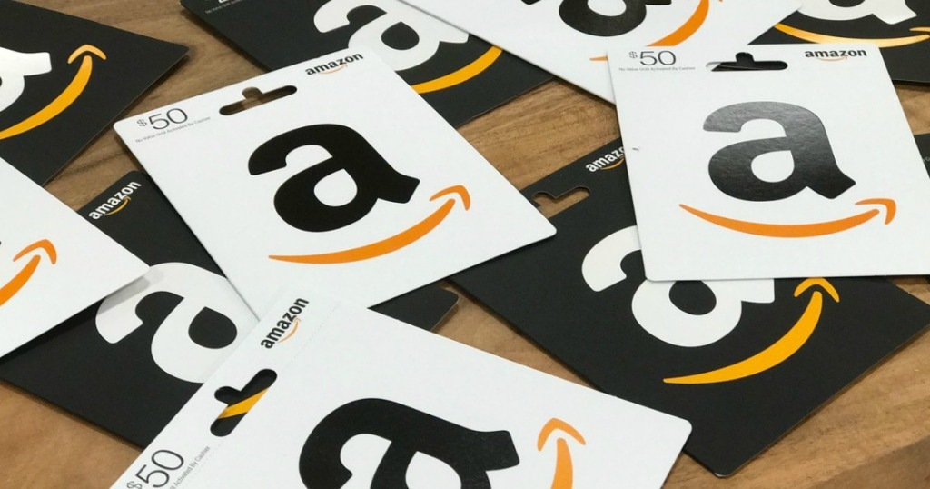 amazon gift cards scattered on a table