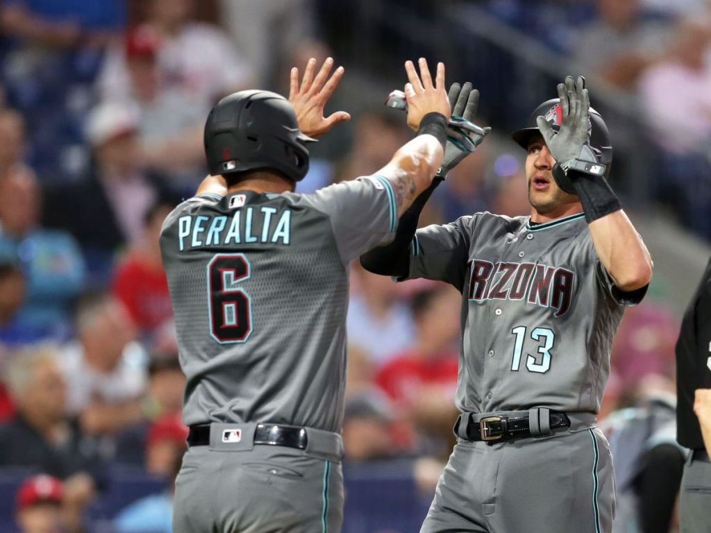 arizona diamondback players Nick Ahmed and David Peralta giving high fives in the game